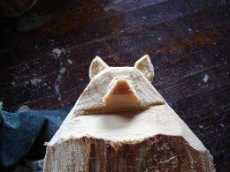 creates the neck line of the raccoon carving
