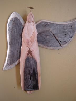 finished piece of angel wood carving sculpture